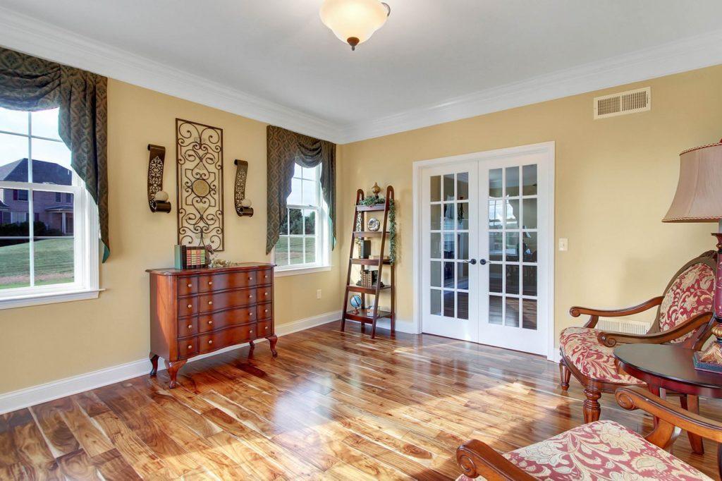 JLH CUSTOM HOME - Study with hardwood flooring