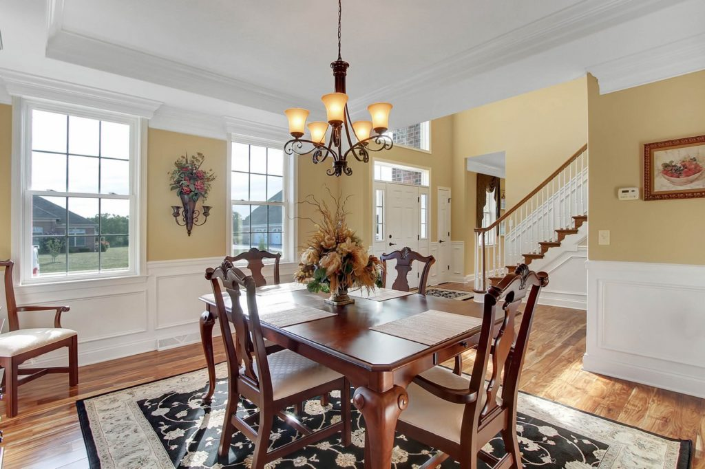 JLH CUSTOM HOME - Dining Room with hardwood flooring
