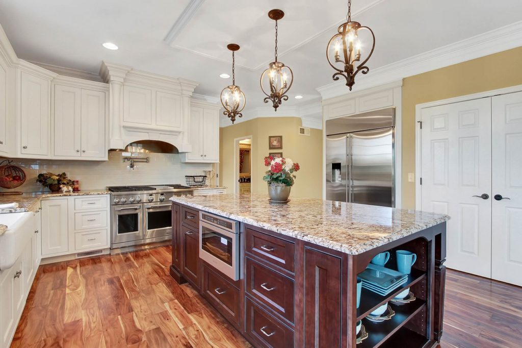 JLH CUSTOM HOME - Kitchen with Custom Cabinetry and oversized island